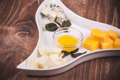 Cheese platter with jam Stock Photo