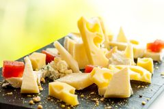 Cheese platter. Macro close up of fresh cheese platter Stock Photos