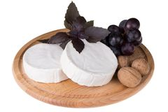 Cheese platter with  nuts and  grapes Stock Photography