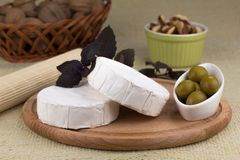 Cheese platter with  nuts and  grapes and olives Royalty Free Stock Image
