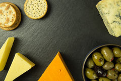 Cheese platter with olives and biscuits. Tasty cheese platter with olives and biscuits stock image