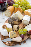 Cheese platter, snacks, bread and wine Royalty Free Stock Photography