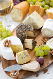 Cheese platter, snacks, bread and wine, vertical Royalty Free Stock Photo