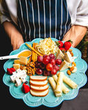Cheese platter. Variety of cheeses accompanied by royalty free stock photos
