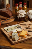Cheese platter with various cheeses. Stock Photos