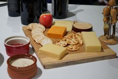 A cheese platter with wine stock image
