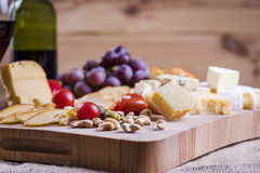 Cheese platter. And wine - a light snack Royalty Free Stock Photo