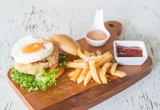 Cheese pork hamburger. With french fries Royalty Free Stock Photos