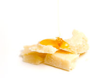 Cheese with pouring honey Royalty Free Stock Photos