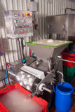 Cheese processing Stock Images