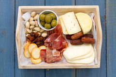 Cheese with prosciutto, bread, dry fruits Royalty Free Stock Photo