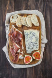 Cheese, prosciutto and bread Stock Images