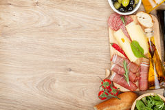 Cheese, prosciutto, bread, vegetables and spices Stock Image