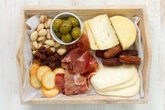 Cheese with prosciutto Stock Photos