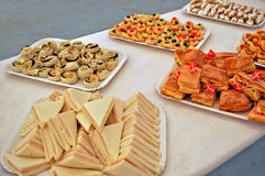 Cheese and prosciutto sandwiches. Sandwiches and pastries for a party Stock Photography