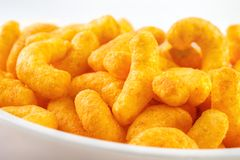 Cheese puff closeup. Cheese puff snacks on bowl closeup Stock Images