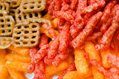 Cheese puffs, Colorful Cheetos, mini Pretzels Royalty Free Stock Photography