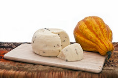 Cheese and Pumpkin. Truffle cheese and crackers on a cutting board stock photography