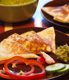 Cheese quesadilla. With garnish ready to be served royalty free stock photo