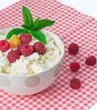 Cheese with raspberries Royalty Free Stock Photo