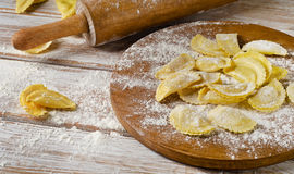 Cheese ravioli on a  wooden board. Cheese ravioli on  a wooden board. Selective focus Stock Photography