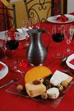 Cheese and red wine. A fine dinner table in France royalty free stock photos