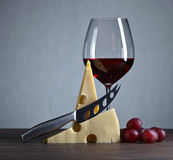 Cheese and red wine on a old wooden table Royalty Free Stock Photography