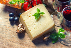 Cheese with red wine, walnuts and grapes. food background Stock Photo