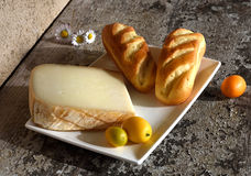Cheese and rolls. Products for breakfasts on a summer table Royalty Free Stock Photography