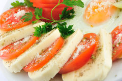 Cheese rolls with tomatoes slices Stock Photography