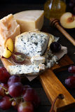 Cheese roquefort and grapes Royalty Free Stock Images