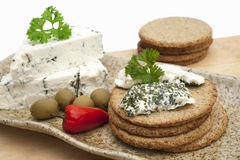 Cheese roule with herbs and crackers Royalty Free Stock Photos