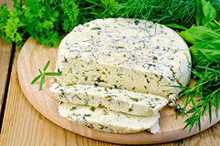 Cheese round homemade with herbs chopped Royalty Free Stock Photo