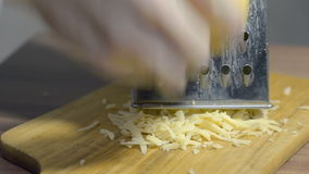 Cheese rub on a grater stock footage