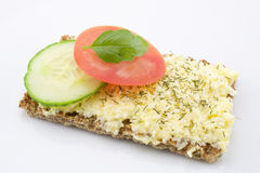 Cheese salad on crisp bread. And vegetables on white background Stock Image