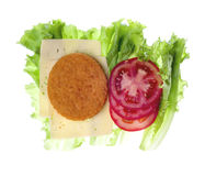 Cheese, salad, fish cake and tomato isolated on white Stock Photo