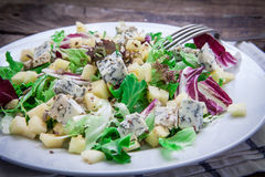 Cheese salad on plate. Healthy salad with gorgonzola cheese and apple Royalty Free Stock Photos