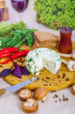 Cheese and salad on the wooden board. With chili, ruccola and mushrooms Stock Image