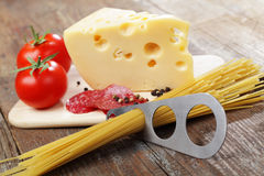 Cheese and salami. Piece of yellow cheese and sliced salami stock images