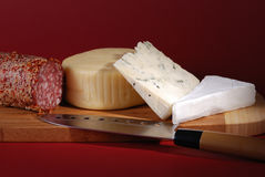 Cheese and salami Stock Photos