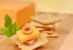 Cheese and salami appetizer Stock Photos