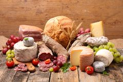 Cheese and salami. Assorted cheese dairy product and salami royalty free stock photo
