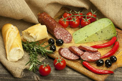 Cheese, salami and bread  on a board Royalty Free Stock Photo
