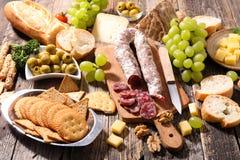 Cheese,salami and bread Stock Photos