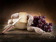 Cheese salami and  grapes Stock Images