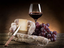 Cheese salami grapes and wine Royalty Free Stock Photo