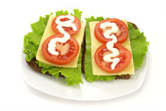 Cheese Sandwich. Sandwich with cheese, lettuce and tomatoes with mayonnaise Stock Images
