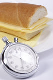 Cheese sandwich. Isolated cheese sandwich and stop-watch stock images