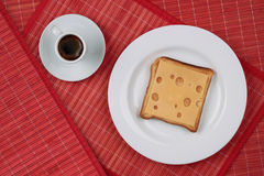 Cheese sandwich and a cup of black coffee Stock Image