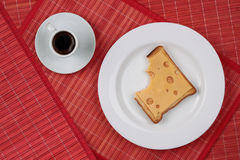 Cheese sandwich and a cup of black coffee Stock Images